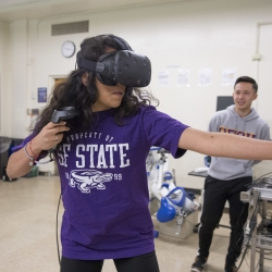 A student playing a Virtual Reality game